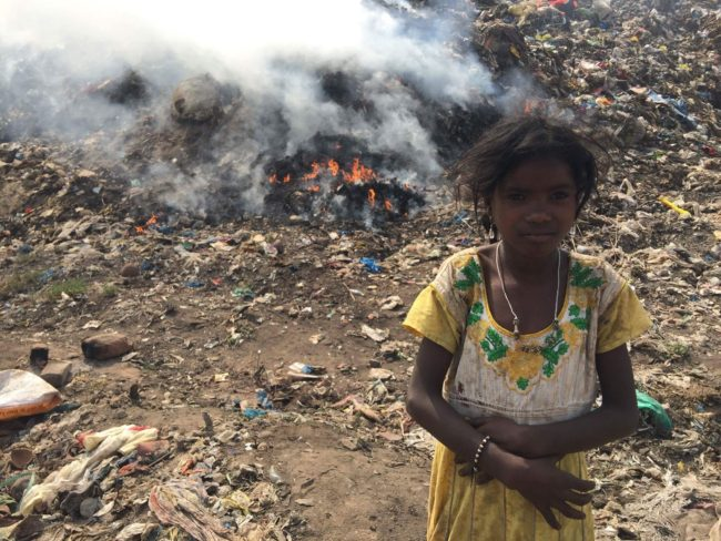 Smoke from burning rubbish is silently damaging the health of children and adults living on the Vijayawada dump