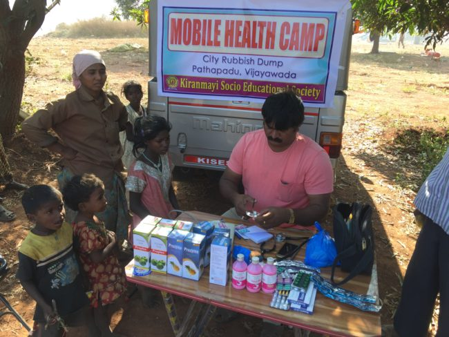 The first patient is seen by Dr Reddy at the inaugural KISES Mobile Health Camp at Vijayawada Dump